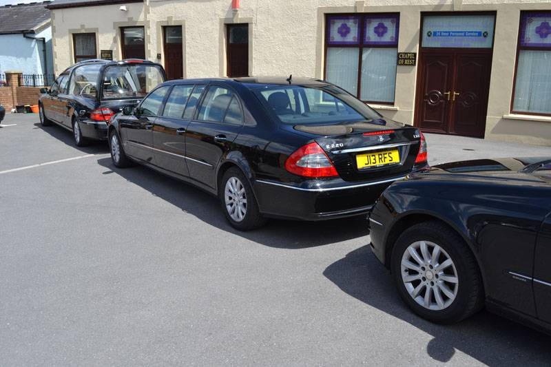 funeral cars parked outside